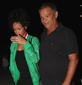 Rihanna having a dinner with her Dad 06-29-2014