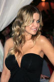 Carmen Electra shows cleavage in low-cut tight black dress at the Pool in Harrah's Resort in Atlantic City
